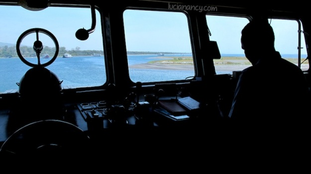 View from behind the captain's wheel.